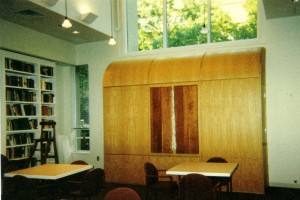 In this multi-use setting at M.I.T. Hillel, the ark is contained in a wall unit that captures the cascading light from the clerestory windows and echoes the cascade with a subtle waterfall sculpture that is seen when the ark is not in use for services. The wall unit contains storage facilities and houses a second, portable ark that is used on the High Holidays.
